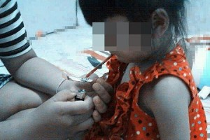 Picture of a Thai Toddler Smoking Meth Posted on Facebook